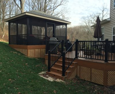 sun room addition separated from home on dark brown outdoor deck