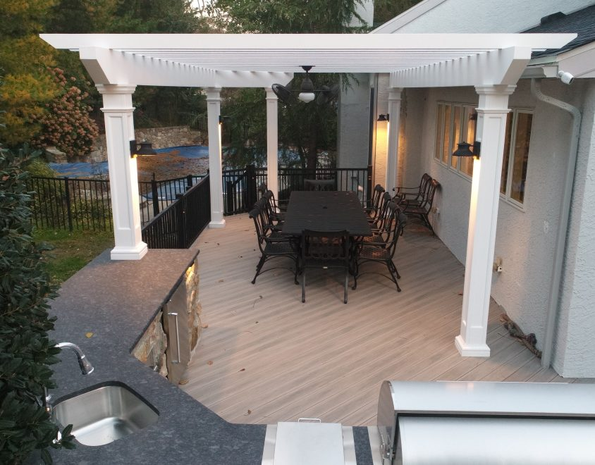 backyard dining and recreational area with pergola and furniture set