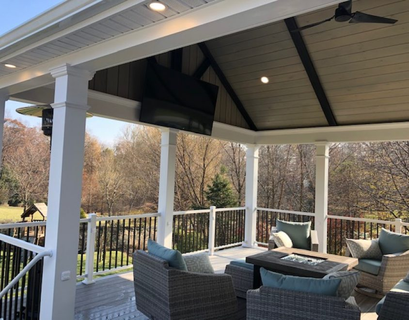 backyard porch with outdoor furniture and white porch columns