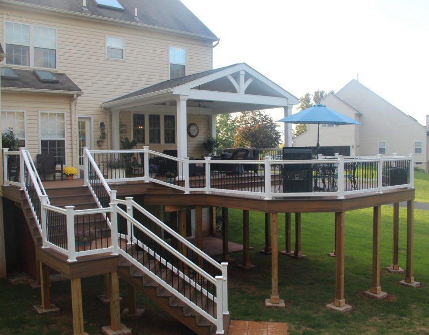 custom backyard deck with white vinyl handrails