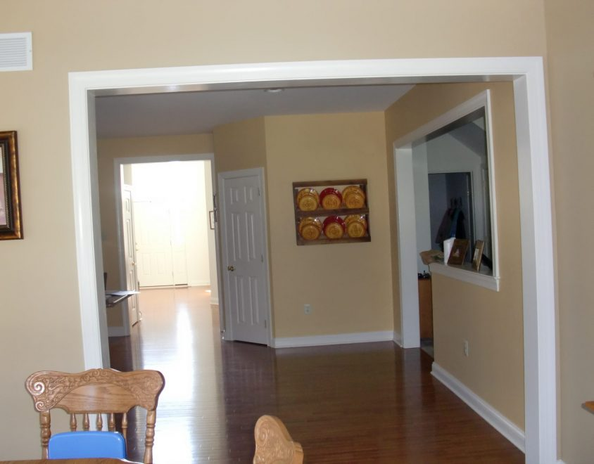 interior living space with brown hardwood floor and tan painted walls
