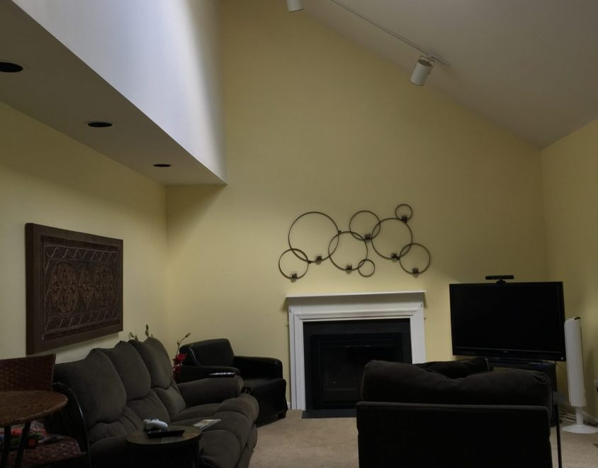 newly remodeled interior living space with furniture and decorations