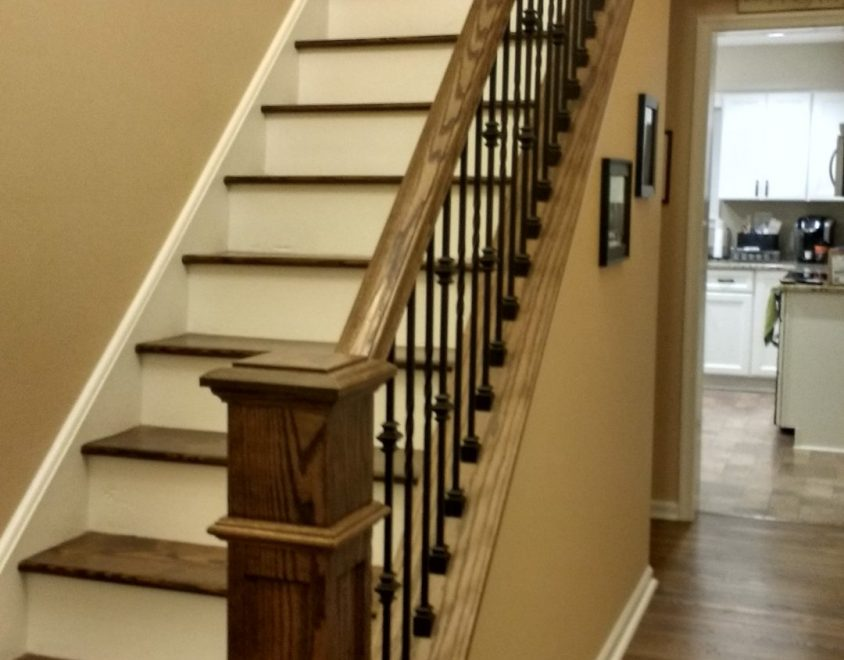 newly built white staircase with wood handrail